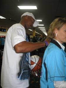 Hornets coach Byron Scott signing autographs