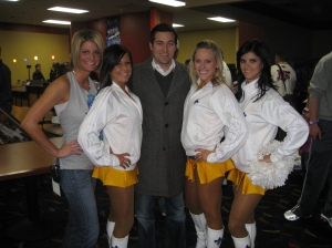 Brittany Cranston from the Hornets PR department and Travers pose with some Honeybees