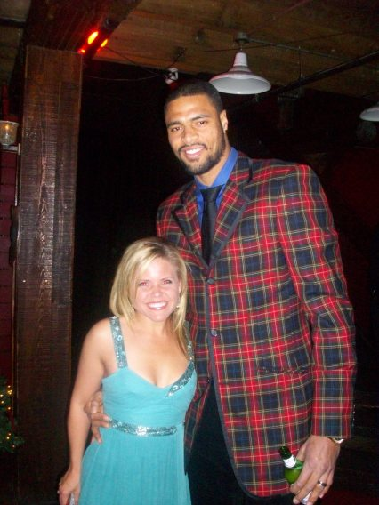 WDSU reporter Randi Rousseau (5'1) and Hornets center Tyson Chandler (7'1) at the Hornets holiday party.