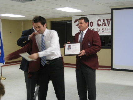 Travers Receiving His Maroon Hall of Fame Jacket